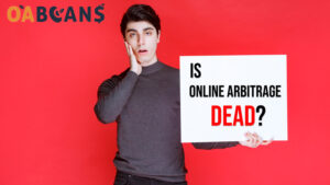 "The surprised man holds a sign that written "" is online arbitrage dead"" on it"